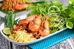 Pad thai, Thai cuisine on a wooden table. Royalty Free Stock Image