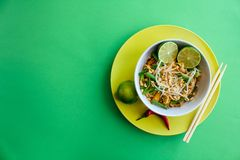 Pad thai, top view on green background royalty free stock photography