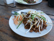 Pad thai on white dish. On wooden table Royalty Free Stock Photo