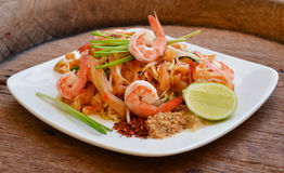 Pad thai. On wooden background Royalty Free Stock Photos