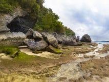 Padang padang beach after tide ocean Stock Photo