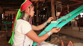 Padaung Tribe Women Weave. Unidentified Padaung Karen tribe women weave on traditional device. Padaung women wear brass  rings on the neck since the age of 5 stock footage