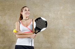Padde tennis woman posing on concrete wall Stock Image