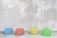 Padded stools in concrete room Royalty Free Stock Photos