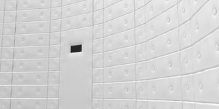 Padded white cell. Interior details of padded white cell with peephole in door Stock Photography