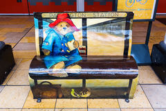 Paddington Bear bench at Paddington station in London, UK Stock Image