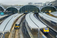 Paddington railway station in London. Train leaves Paddington railway station in London, UK Stock Photo