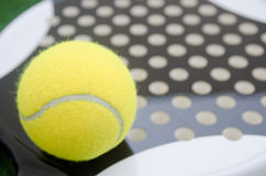 Paddl etennis ball on racket Royalty Free Stock Photo