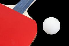 Paddle. Pingpong paddle and ball - isolated on black background Royalty Free Stock Image