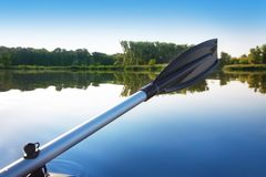 Paddle against the morning river landscape Stock Image
