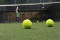 Paddle ball in astroturf court. In the night and blur layer Stock Photos