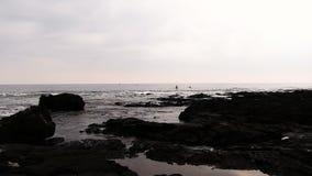 Paddle Board And Kayak Off Black Lava Shore Kona Hawaii stock video