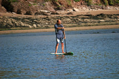 Paddle boarder. On River Avon royalty free stock photo