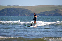 Paddle boarder. Stand up paddle boarder surfing Royalty Free Stock Image
