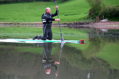 Paddle boarder. On the River dart Royalty Free Stock Photography