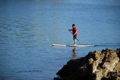 Paddle boarder on Crescent Bay, Laguna Beach, California. Royalty Free Stock Photography