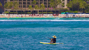 Woman paddle boarding on a beautiful day in Waikiki Stock Image