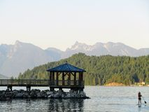 Paddle boarder paddling on the open ocean outside Gibsons, Briti royalty free stock photography