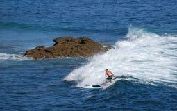 Standup paddle boarder surfing off Heisler Park, Laguna Beach, California. Royalty Free Stock Image