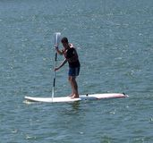 Paddle Boarder On The Tagus River In Lisbon Portugal royalty free stock images