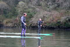 Paddle boarders. On the River Dart Stock Photography