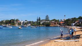 Paddle Boarders and Anchored Yachts, Watsons Bay, Sydney, Australia. Paddle board instruction on the yellow sand beach at Watsons Bay, Sydney Harbour, Sydney Stock Photos