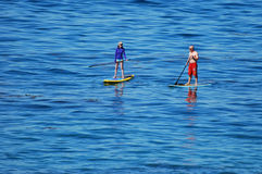 Paddle boarders off Heisler Park, Laguna Beach, California. Image shows a pair of paddle boarders off Heisler Park coastline in Laguna Beach, California royalty free stock photos