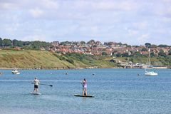 Paddle boarders in Portland Harbour stock photos