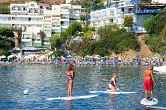 Paddle boarding in Bali, Crete. Royalty Free Stock Photography