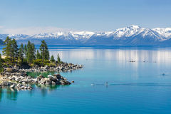Paddle boarding Lake Tahoe royalty free stock photos