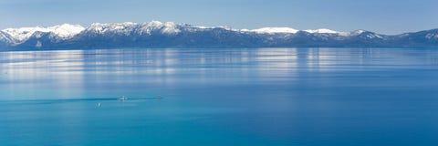 Paddle boarding Lake Tahoe Royalty Free Stock Photos