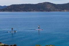 Paddle boarding, Lake Tahoe Royalty Free Stock Images