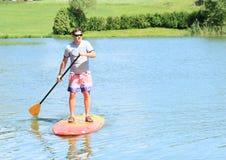 Paddle-boarding man Royalty Free Stock Photo