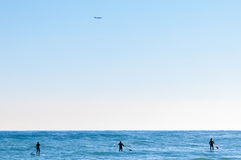 Paddle-boarding on open water Stock Photo
