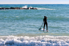 Paddle-boarding on open water Stock Images