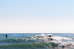 Paddle-boarding on open water Royalty Free Stock Image