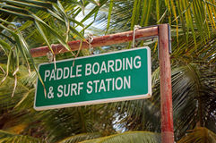 Paddle Boarding Surf Sign. Paddle Boarding and Surf Station sign stock photos