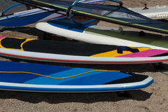 Paddle Boarding and winsurfing Rentals on the Beach Stock Image