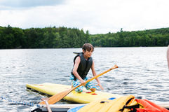 Paddle boarding Stock Photography