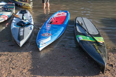 Paddle boards with very different paint jobs royalty free stock photography