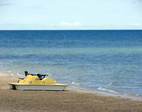 Paddle Boat. And table on the beach royalty free stock photo