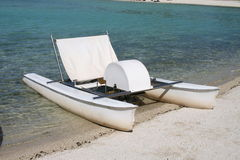 Paddle boat on the beach Royalty Free Stock Photography