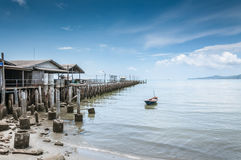 Paddle boat and bridge fishing pier Royalty Free Stock Images