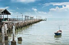 Paddle boat and bridge fishing pier Royalty Free Stock Photography