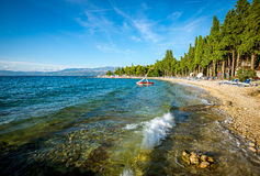 Paddle boat at sea. Adriatic sea at Brac island in Croatia and Paddle Boat - Pedalo Stock Photos