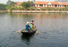 Paddle boat with tourists in Ninh Binh, Vietnam Stock Photo