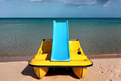 Paddle boat with water slide Stock Image