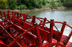 Paddle boat wheel spinning in the water Stock Photos
