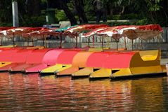 Paddle boats with canopies in a lake. Pedalos stock image