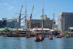Paddle Boats in the Harbor. Baltimore, MD, USA --April 13, 2019-- Tourists ride colorful paddle boats in Baltimore`s inner harbor on a spring afternoon stock photo